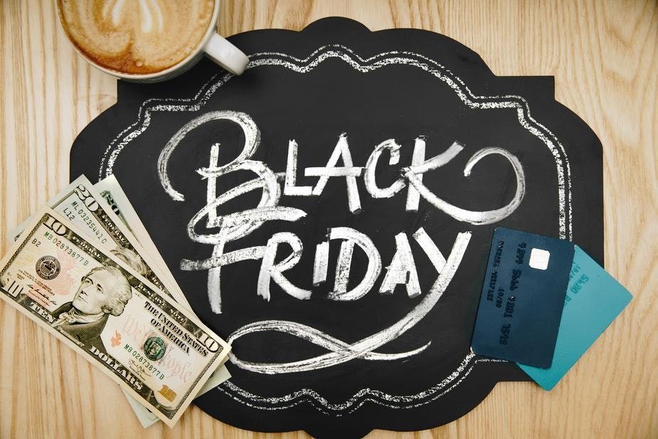 black Friday facts chalk board with money and credit card