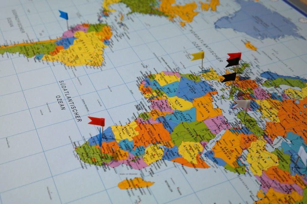 picture of a map with flags stuck in countries