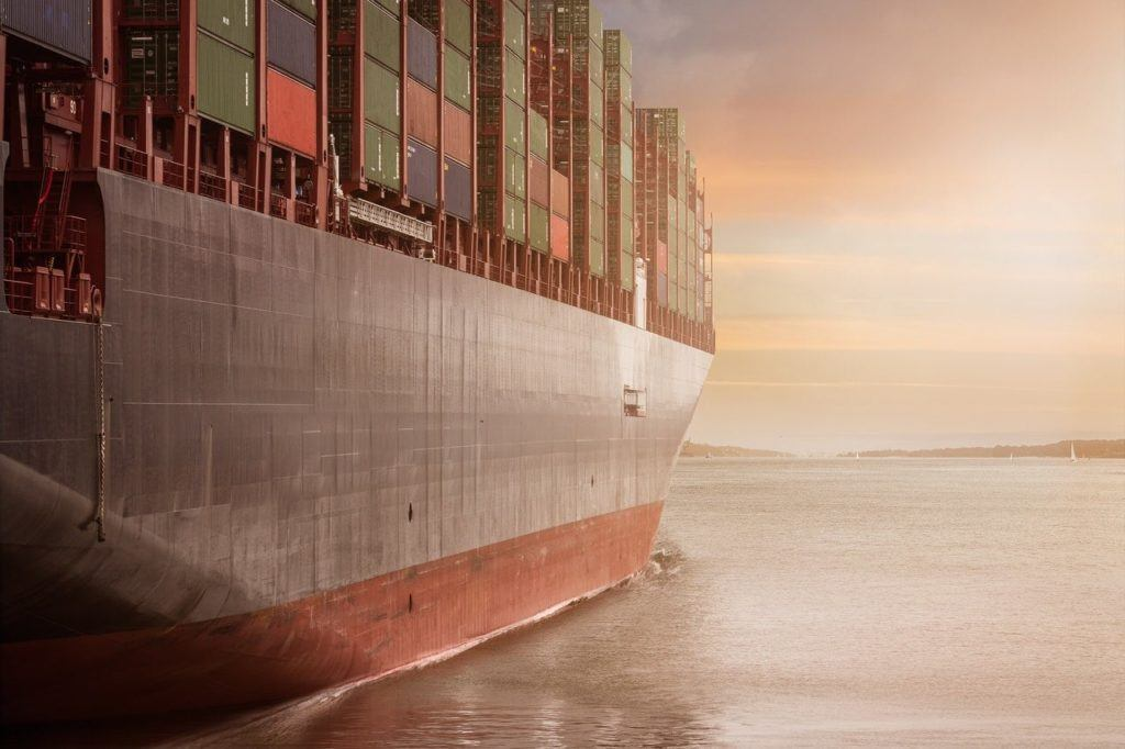 Large ship carrying containers indicates shipping costs