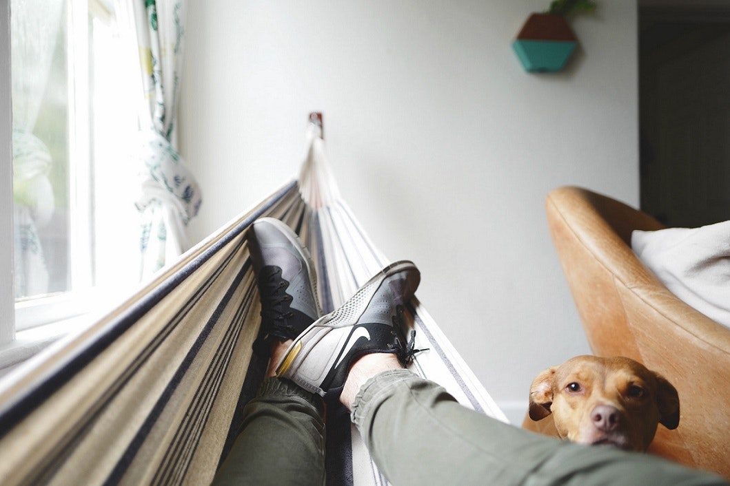 view of person's feet while resting on a hammock
