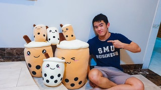 Tze Hing Chan with boba plush toys