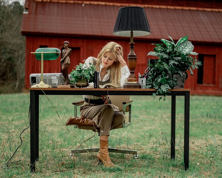 woman sitting at an outdoor desk