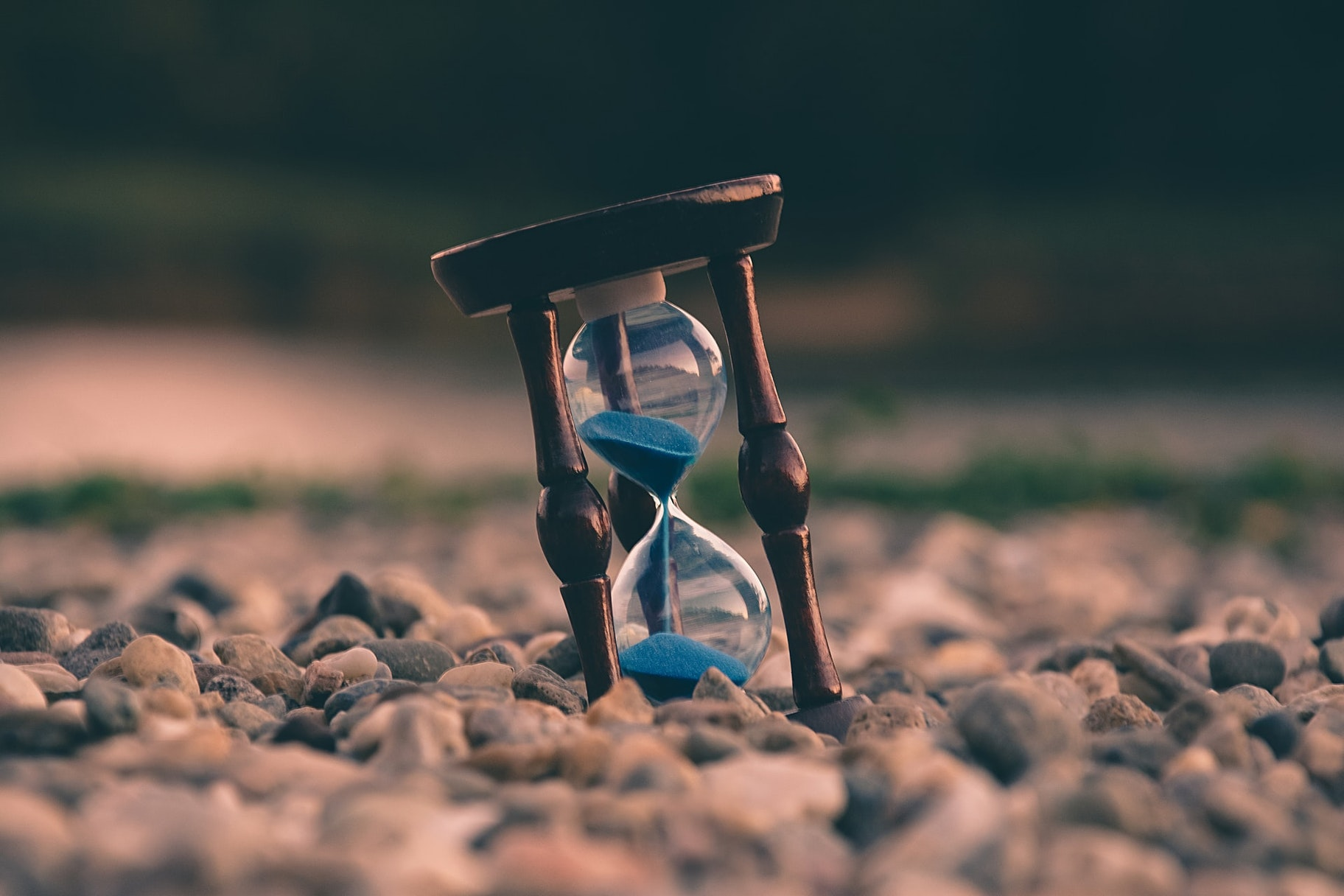 an hourglass on the ground