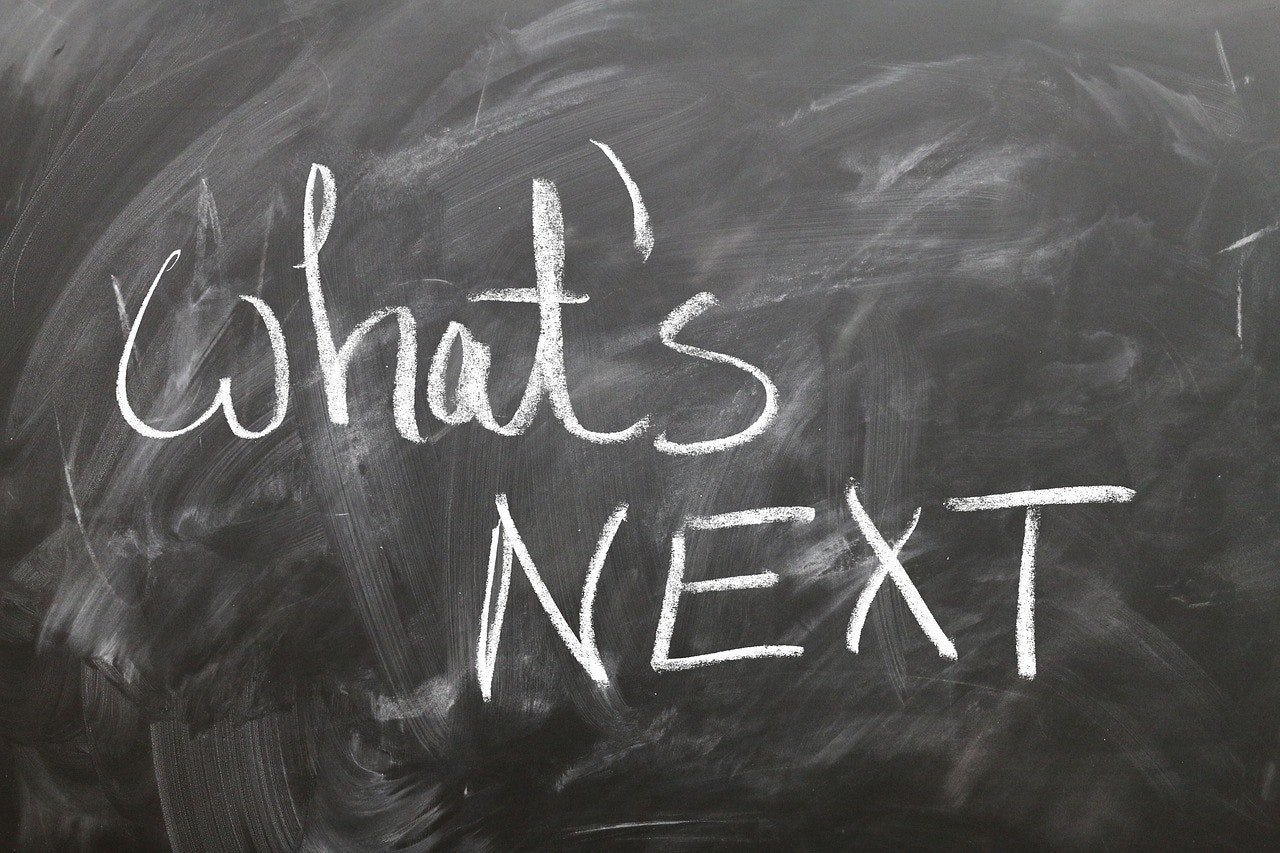 'what's next' on chalkboard