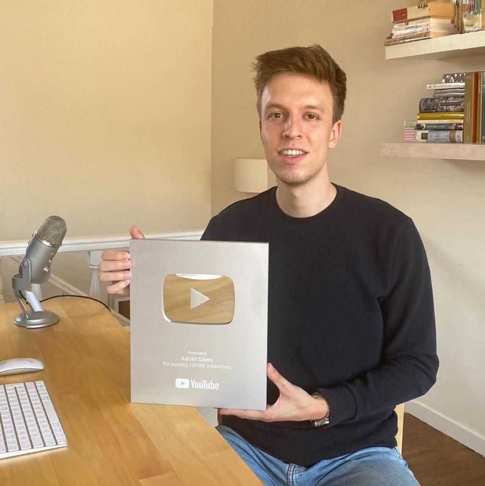 Adrian Saenz holding YouTube plaque