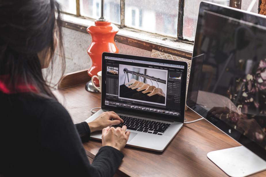 A woman edits product photos