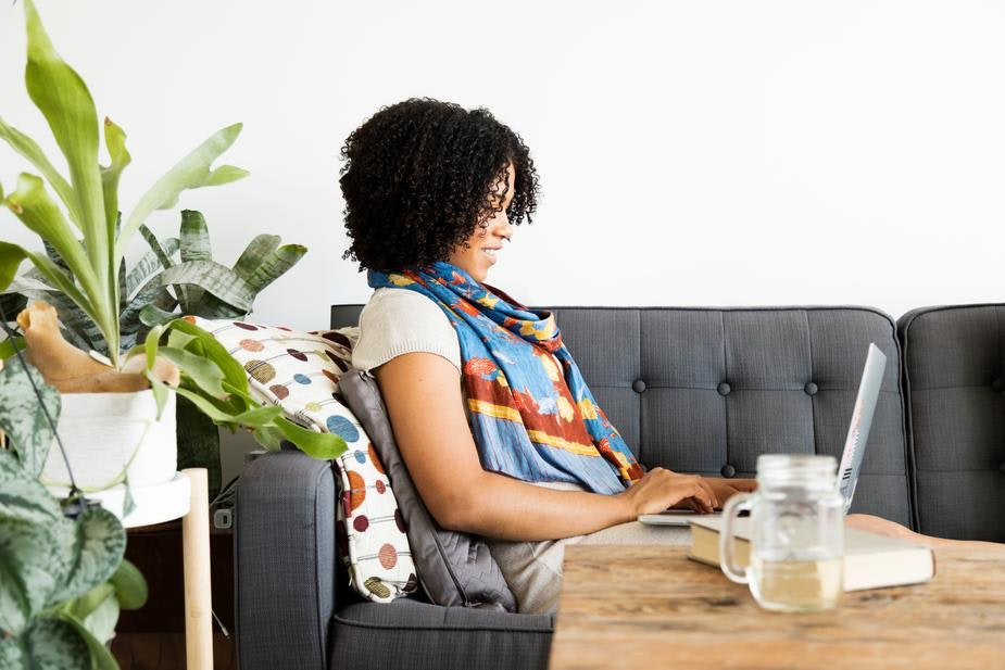 woman works from home on her couch
