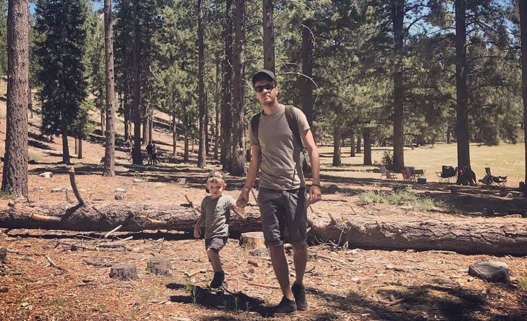 Pierre and his son in the forest