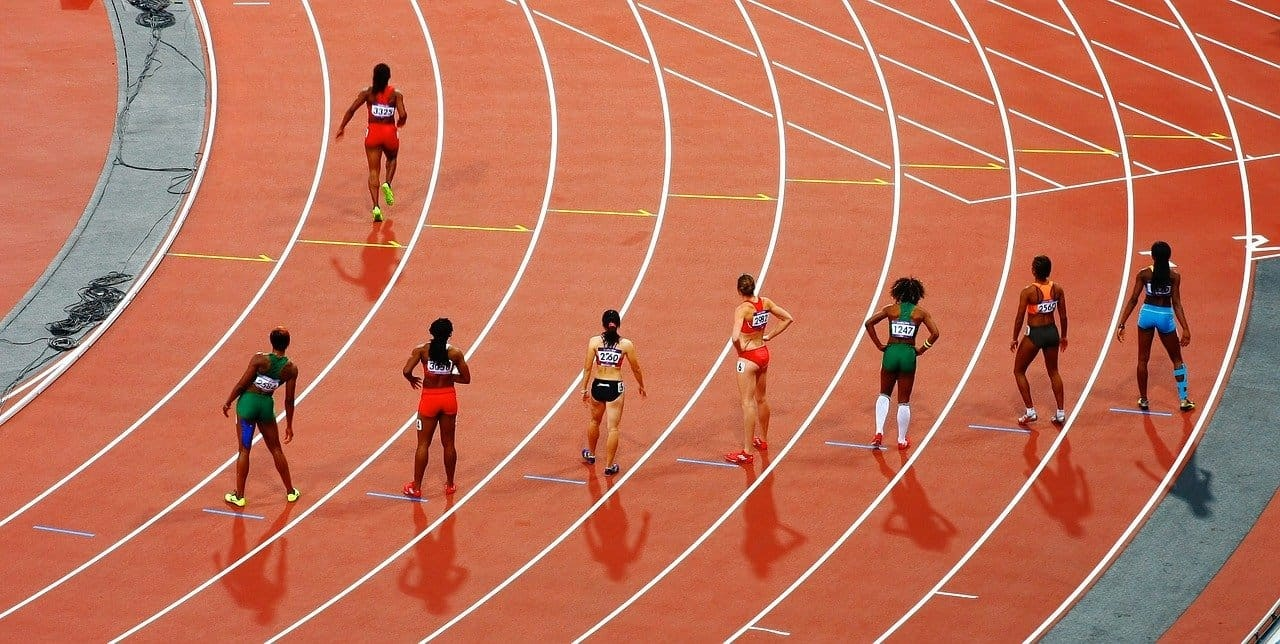 eight athletes preparing to race on a running track