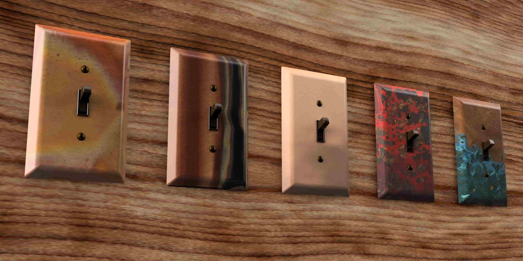 A picture of five different copper wallplates
