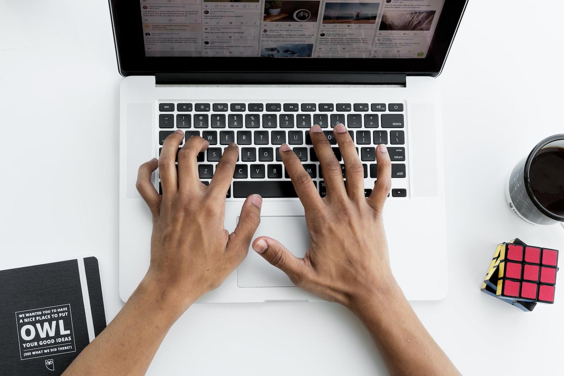 1603954239 making a social media post on laptop