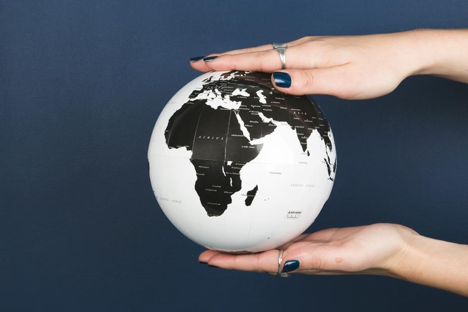 womans hands holding a globe