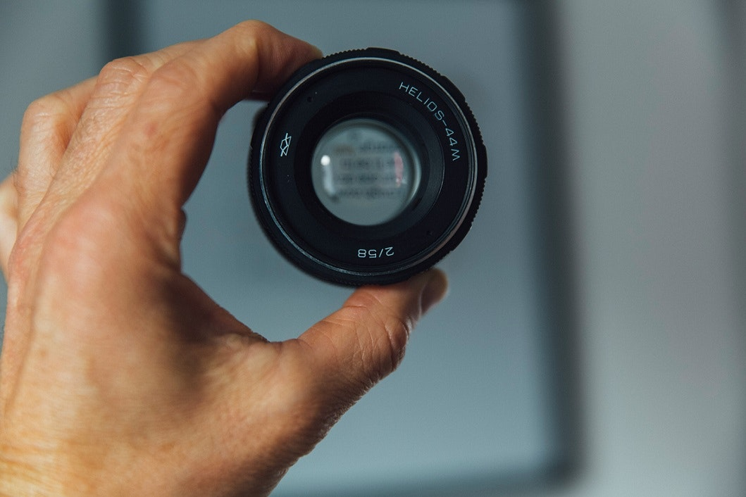 Hand holding up camera lens